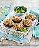 Gratinated portobello mushrooms with cheese and mincemeat stuffing