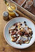 Kaiserschmarrn (scrambled pancakes) with raisins and applesauce