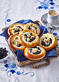 Yeast pastries with custard and blueberries