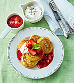Coconut pancakes with strawberry sauce