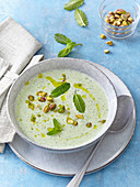 Cold cucumber soup with mint and pistachios