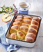 Sweet buns with custard and apples