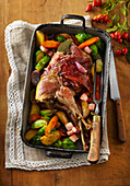 Pheasant with striped bacon and vegetables