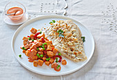 Piquant sweet potato salad with bass (perch)