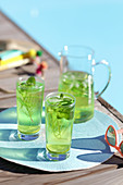 Chilled detox drink with fresh mint and salvia leaves