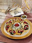 Pizzaring mit Spinat und Salami zu Silvester