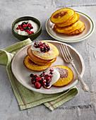 Pumpkin pancakes with berries and yogurt