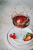 Strawberry splash into red wine