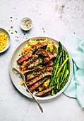 Beef steak with potato and corn puree and green asparagus