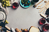 Red wine with charcuterie assortment on grey background, food frame