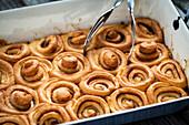 Cinnamon buns in a baking pan