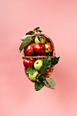 Organic apples in basket on pink background
