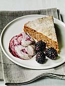 slice of blackberry cake served with blackberry cream