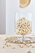 Truffle popcorns in a large glass jar inside in a white room