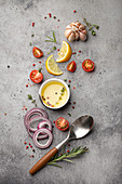 Vegetables, herbs, spices, olive oil and kitchen spoon
