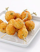 Fried rice balls on skewers