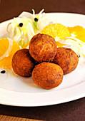 Cod balls with fennel and orange salad