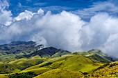 Clouds over grass hills
