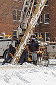 Workers putting up a utility pole