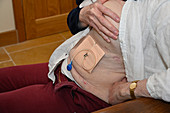 Patient with dressing applied after a chest drain