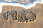 H2O written in the sand