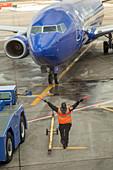 Ground crew directing an aircraft