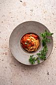 Marinara pasta in a grey bowl