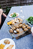Chicken and hasselback potatoes on table