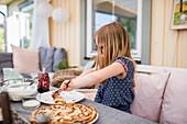 Girl at table eating pancakes