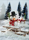 Marzipan snowman on a mini sledge