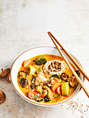 Asian soup with vegetables, shiitake mushrooms and sesame