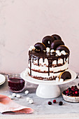 Cranberry cake lavishly decorated with donuts and marshmallows