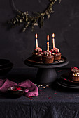 Chocolate cupcakes with lit candles