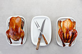 Roasted duck and chicken on white plate
