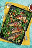 Grilled mackarel with crispy new potatoes, beans, peas, asparagus and tomato basil salsa