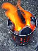 Lit coal briquettes