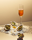 Oysters au gratin with a tea and champagne cocktail