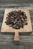 Fungi black trumpets on a wood cutting board