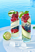 Refreshing summer cocktails with berries and cucumber