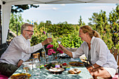 Mature couple having meal in garden