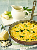 Frittata with spring onions, parmesan cheese and mint