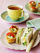 Egg, cress and cucumber sandwiches with red pepper and goats cheese tarts