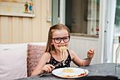 Girl having meal outside