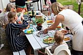 Family having meal outside