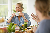 Happy woman at table