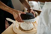 Hands making bread