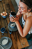 Woman at breakfast table with coffee