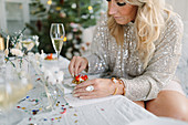 Woman eating snack at festive table