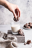Dipping Gluten free Chocolate Crackle Cookies