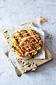 Okonomiyaki (Japanese cabbage pancakes with bonito flakes)
